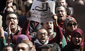 Egyptian doctors shout anti-police slogans during a protest against rampant police abuses. Doctors have threatened to escalate if the government doesn''t hold police accountable for abuses.
