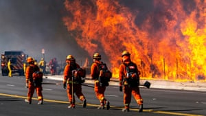 Inmate firefighters battle the Easy fire in Simi Valley, California. The state has for decades deployed thousands of incarcerated people to respond to wildfires.
