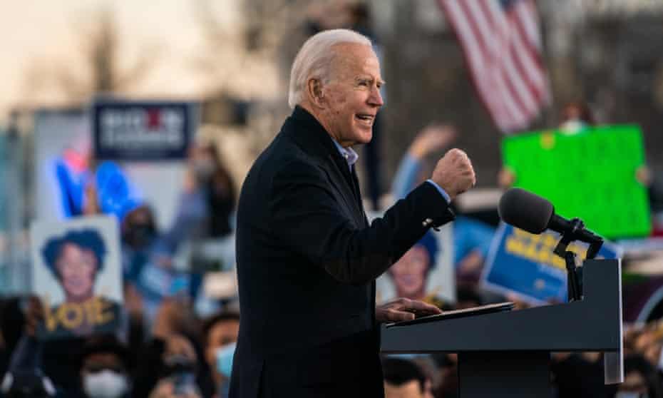 President- elect Joe Biden campaigns for Democratic Senate candidates Jon Ossoff and Raphael Warnock at in Atlanta, Georgia, on Monday.