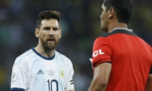 Argentina's Lionel Messi, left, complains to to referee Roddy Zambrano during the Copa América semi-final.