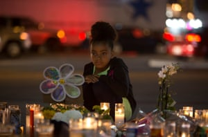 A girl looks at a makeshift memorial for victims of the Las Vegas mass shooting on Sunday