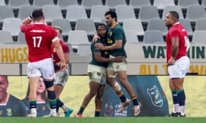 South Africa's Lukhanyo Am celebrates with Damian de Allende after scoring a try.