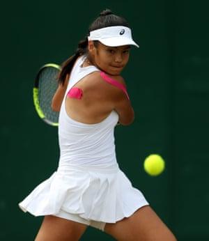 Raducanu during a girl's singles match at Wimbledon in 2017