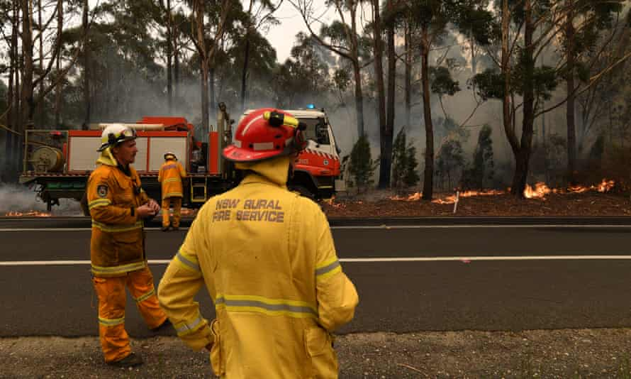 Rural Fire Service volunteers contain a bushfire south of Ulladulla, New South Wales