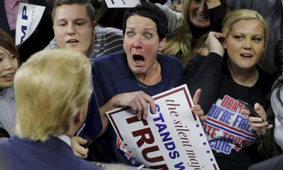 Donald Trump greetsan excited supporter at a campaign rally in Lowell, Massachusetts.