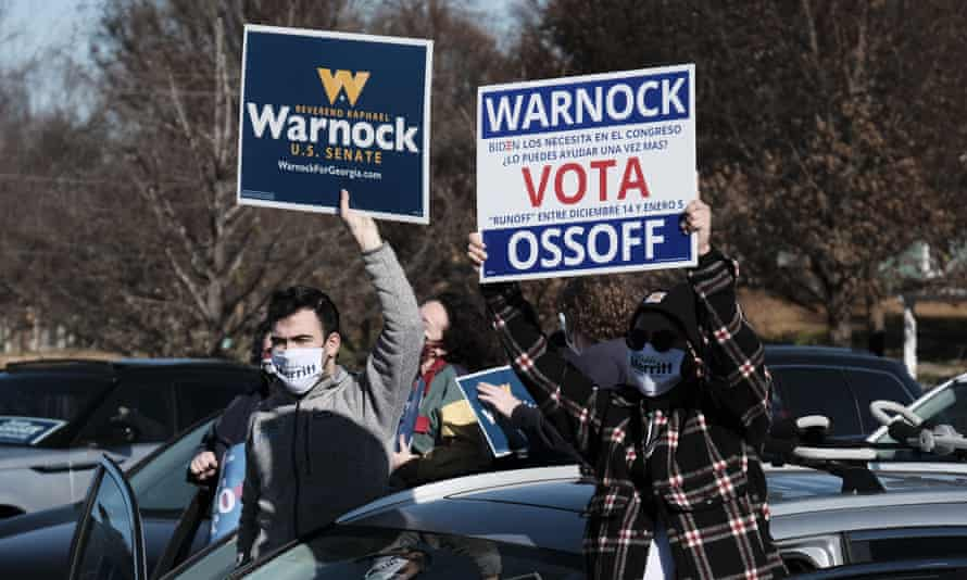 Supporters rally for Democratic Senate candidates Jon Ossoff and Raphael Warnock on 14 December.