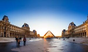 The Louvre Pyramid at sunset, Paris.