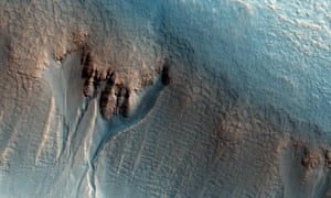 image from Nasa's MRO shows gullies in the northern wall of an unnamed crater in Utopia Planitia