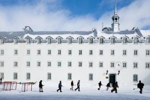 School boys playing broom hockey at recess at Seminary of Québec.