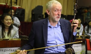 Jeremy Corbyn plays an erhu during a visit to the Pagoda Arts and the Wah Sing Chinese community centre in Liverpool.