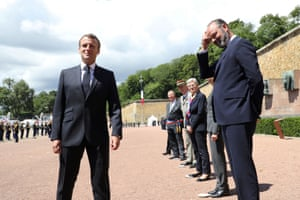 Emmanuel Macron and Édouard Philippe at a second world war memorial on 18 June