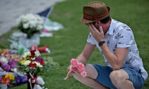 Jonathan Dalton, who lost friends in the attack, visits a makeshift memorial in Orlando, Florida Monday.