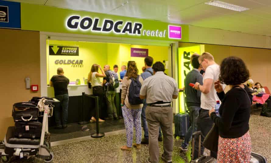 Customers queueing at Goldcar kiosk at Milan airport