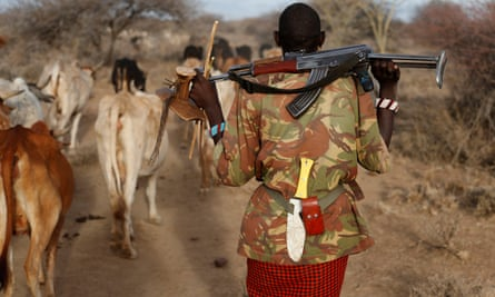 Gunman: an armed tribesman with his cattle in Kenya.