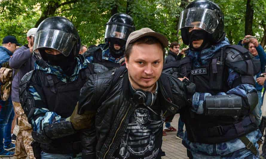 Russian National Guard servicemen detaining a man after a rally in Moscow calling for fair elections on 10 August.
