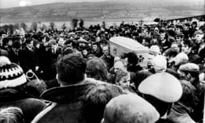 Pallbearers carry one of 13 coffins of Bloody Sunday victims during a funeral in Derry, Northern Ireland.