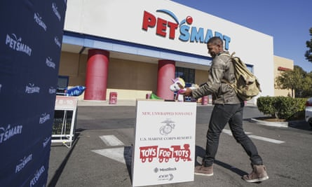 A customer donates a toy during a Toys for Tots drive outside of Petsmart in Vista, California, in November 2019.