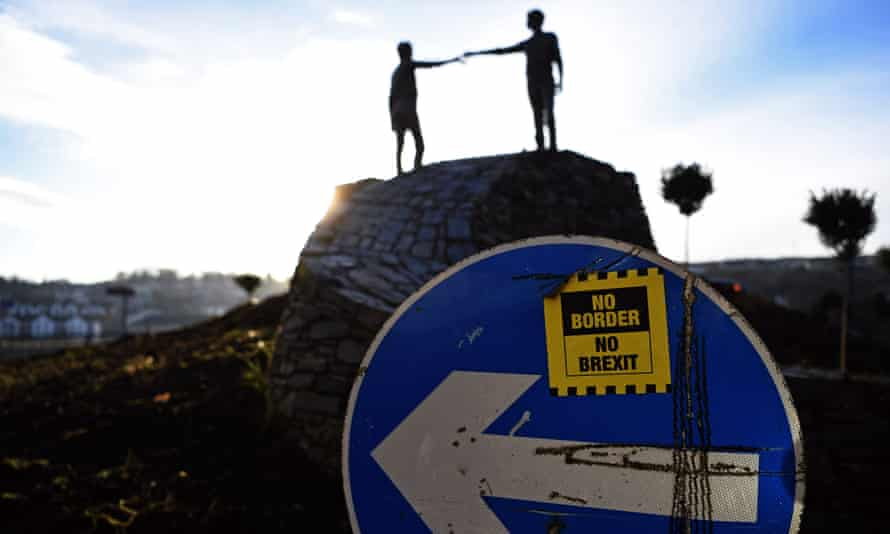The sculpture Hands Across the Divide by northern Irish sculptor Maurice Harron is seen in Londonderry in Northern Ireland.