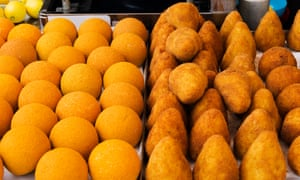 Round and conical arancini; the latter are inspired by the shape of Mount Etna.