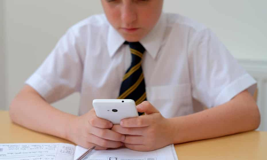 School pupil using a mobile phone