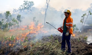 Stafford Yam uses a drip torch to create a fire break in savannah woodland at Oriners station in Cape York, Queensland on 29th June, 2016. The Oriners and Sefton Savannah Burning Project creates carbon credits, using strict scientific methodologies, approved through a rigorous accreditation process with the Department of Environment, to store carbon in the natural landscape.