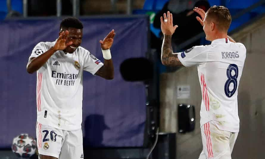Kroos and Vinícius Júnior celebrate after they combined for Real Madrid's opening goal.