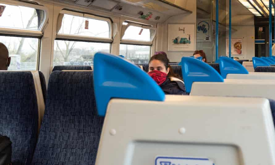 Woman in a mask on a train