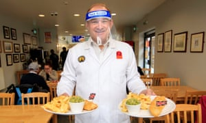 Ed Davey helps out at a fish and chip shop in Stockport during his national 'listening tour'.