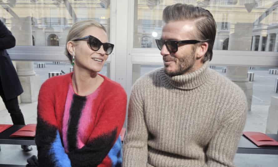 David Beckham with Kate Moss in the front row of the Louis Vuitton show during Paris fashion week