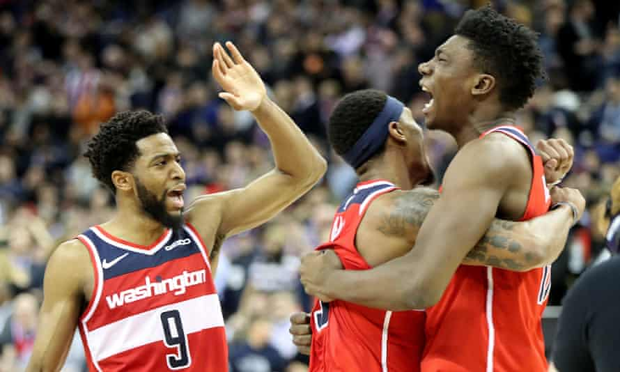 Washington Wizards' Thomas Bryant (right) celebrates with team-mates Bradley Beal (centre) and Chasson Randle at the end of the game in London.