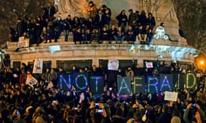 A sign reads 'Not Afraid' as thousands gather for a candle light vigil on Place de la Republique in central Paris hours after the attack on the Charlie Hebdo headquarters in Paris.