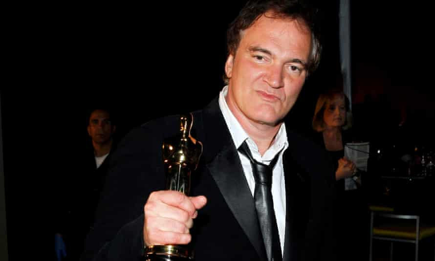 Quentin Tarantino holds his Oscar for the best original screenplay award for Django Unchained after the 2013 Academy awards in Hollywood.