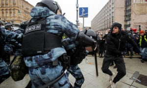 A young Navalny supporter clashes with riot police