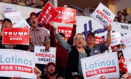 Members of the audience look on Trump delivers remarks at a rally in Rio Rancho, New Mexico, on Monday.