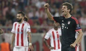 Thomas Müller celebrates his second goal and Bayern Munich's third in their Champions League Group F victory at Olympiakos.