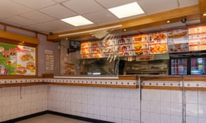Plastic screens are installed in a takeaway in Catford, south-east London, to protect staff and customers.