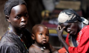 A woman and child in a cave in the Nuba Mountains, South Kordofan