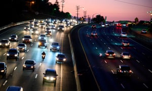 Motor vehicles drive on the 101 freeway in Los Angeles, California , US