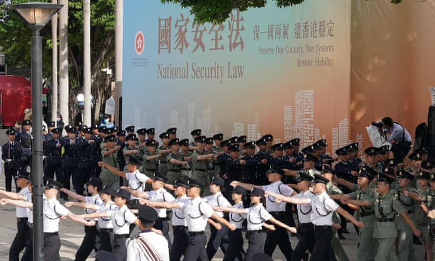 Police form a guard of honour after a flag-raising ceremony to celebrate the 23rd anniversary of Hong Kong's return to China