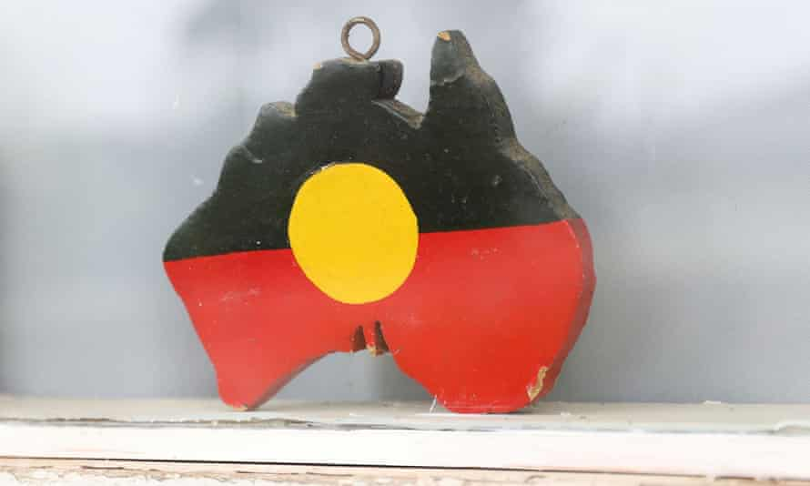 A depiction of the Australian Aboriginal Flag is seen on a window sill