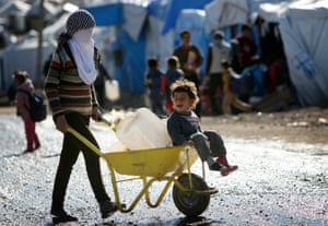Kurdish youngsters collect water at the Kawergosk refugee camp in northern Iraq
