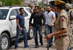 Bollywood actor Salman Khan (second left) arrives at a court in Jodhpur in the western state of Rajasthan, India, before he was sentenced to five years in jail for poaching a protected species of Indian antelope.