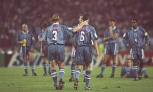 Gareth Southgate is consoled by Stuart Pearce after missing a penalty in the shootout aginst Germany.