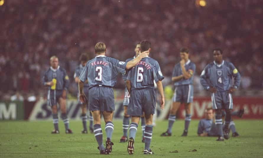 Stuart Pearce (left) consoles teammate Gareth Southgate, now the England manager, after he missed a penalty against Germany in the semi-final at Euro 96.