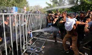 Hungarian police use pepper spray against migrants at the Horgos border.