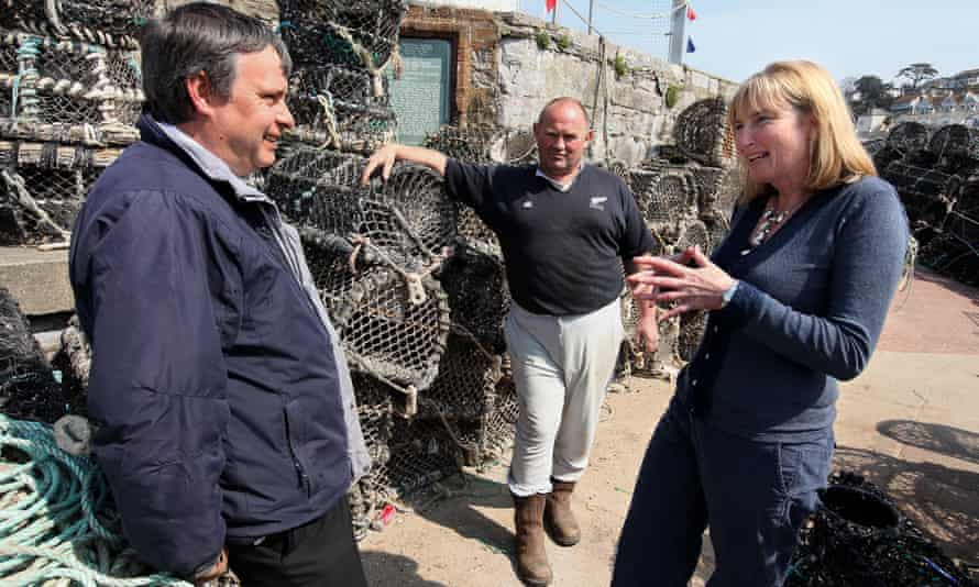 Sarah Wollaston talks to Brixham's harbour master Paul Labistour and local fisherman Rob Adams during campaigning in 2010.