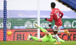 Manchester United's Marcus Rashford scores their first goal.