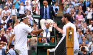 Switzerland's Roger Federer shakes hands with Britain's Cameron Norrie after third round match.