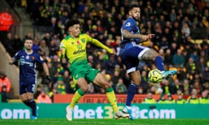 Andre Gray scores Watford's second goal against Norwich City with a backheel.