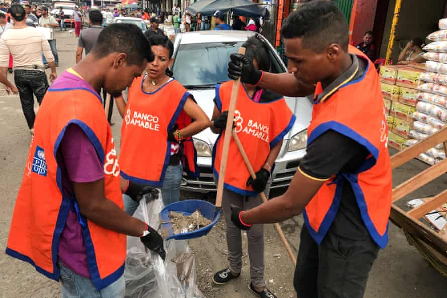 Venezuelan migrants take part in a project to tackle xenophobia on the streets of Maicao.